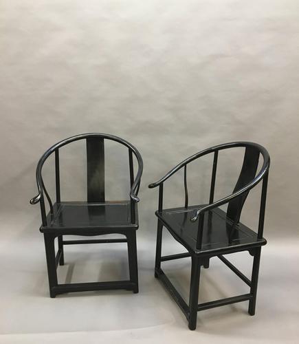 Pair Chinese ebonised horseshoe chairs (1 of 11)