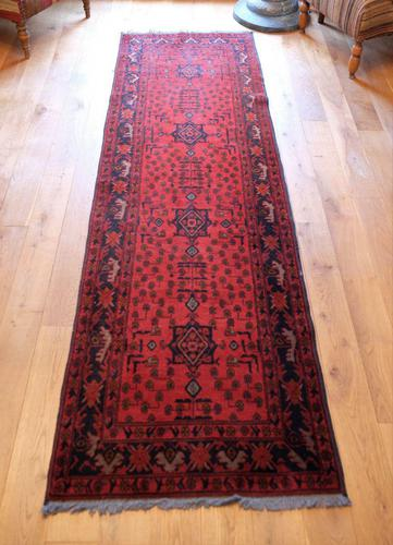 Vintage North West Persian Wool Runner with an all over design upon a red and dark blue ground within multiple borders (1 of 8)