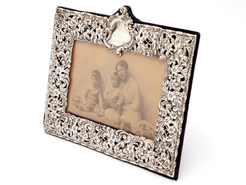Late Victorian Silver Photo Frame Embossed and Pierced with Scrolls and Floral Scenes (1 of 5)
