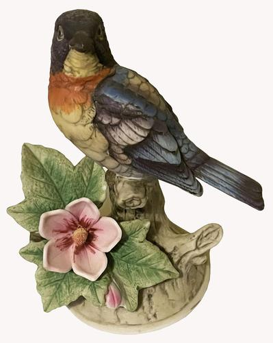 A Porcelain figure of a Paula Warbler by Andrea by Sadek. (1 of 6)