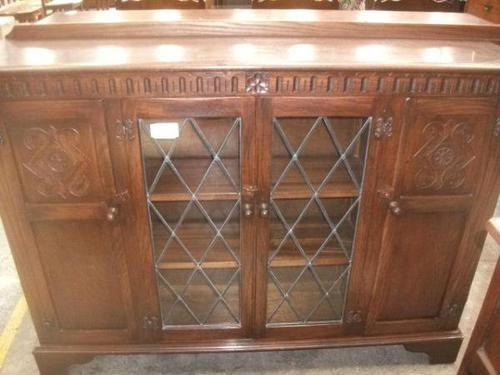 Carved Oak Bookcase with Cupboards (1 of 3)