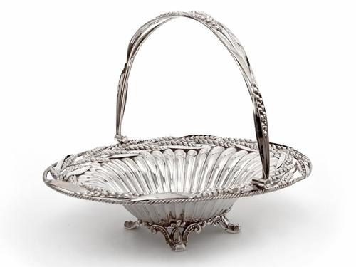 Victorian Oval Silver Plated Swing Handle Basket with Wheat and Rope Border on Four Cast Scroll Feet (1 of 5)