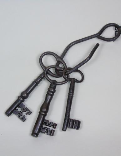 Massive Antique Iron Keys on Beaten Iron Hook (1 of 3)