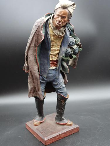 A Very Well Modelled Mid 19th Century Papier-Mâché Figure of a Fruit Seller (1 of 5)