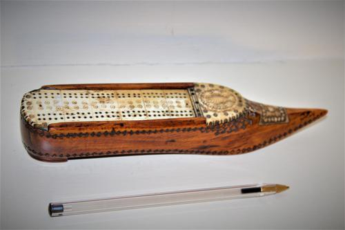 A finely carved 18th century fruitwood cribbage board /box in the shape of a shoe (1 of 7)