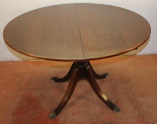 1960s Mahogany Round Table with One Leaf which Folds under Table (1 of 4)
