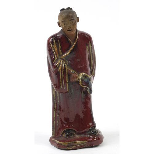 Chinese Porcelain Figure of a Monk Having a sang de boeuf Glaze (1 of 6)