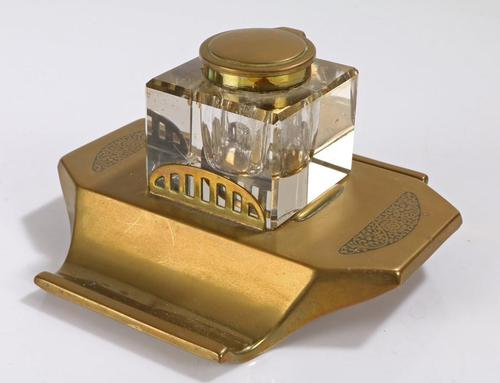 Art Deco brass and glass inkwell, the hinged brass lid above a clear glass body and brass base with two pen trays and engraved foliate scroll decoration, (1 of 12)