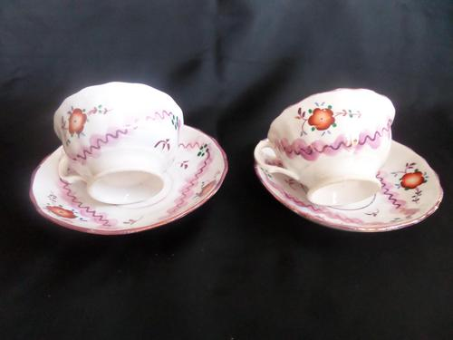 A Pair of Gaudy Welsh Cup & Saucers (1 of 5)