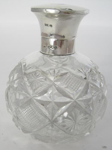 Silver Topped Perfume Bottle with a Hinged Circular Hammered Design Top (1 of 6)