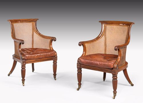 Pair of Regency Period Bergere Library Chairs with Swept Arms (1 of 1)