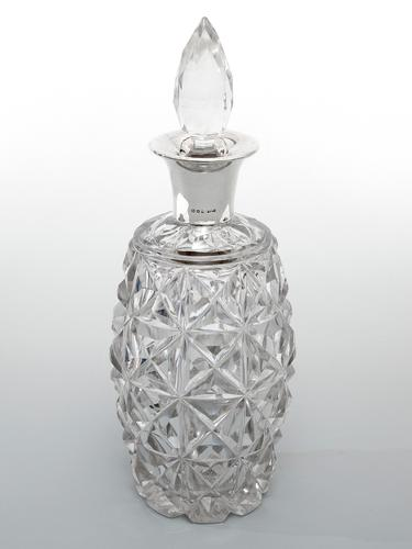Heavy Silver Mounted Decanter with a Glass Barrel Shaped Body & Deep Star Cutting (1 of 3)