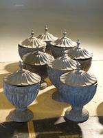 Suite of 8 Late 19th Century Robert Adam Influenced Lead Urns