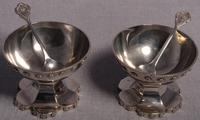 A Pair of Edwardian Arts and Crafts Silver Salt Cellars and Matching Spoons by Liberty & Co, Birmingham 1906