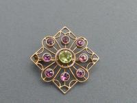 Edwardian 9ct gold, garnet & peridot brooch