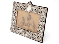 Late Victorian Silver Photo Frame Embossed and Pierced with Scrolls and Floral Scenes