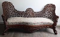 Burmese intricately carved settee in extremely good condition.