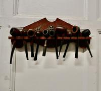Collection of 12 Vintage Tobacco Pipes in a Pipe Rack