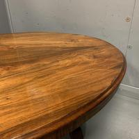 Large oval walnut coffee table with trestle base (4 of 6)