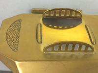 Art Deco brass and glass inkwell, the hinged brass lid above a clear glass body and brass base with two pen trays and engraved foliate scroll decoration, (4 of 12)