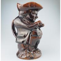 Rockingham Treacle Glazed Snuff-taker Toby Jug Early 19th Century