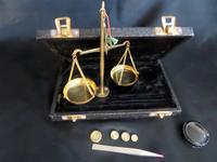 A Travelling Pharmacists (or Jewellers) Travelling Scales with some weights