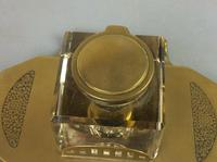 Art Deco brass and glass inkwell, the hinged brass lid above a clear glass body and brass base with two pen trays and engraved foliate scroll decoration, (5 of 12)
