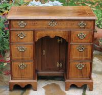 An Early 18th Century Walnut Kneehole Desk