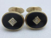 Pair of 9ct gold,onyx and diamond cufflinks