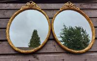 A Pair of 19th Century Oval Gilt Mirrors