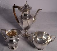 An excellent composite Three Piece Silver Coffee Set in the Art Deco style by Thomas Bradbury, London and Sheffield.