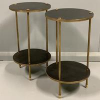 Pair of French ebonised and brass side tables
