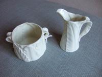 Royal Worcester jug and sugar bowl set, in leaf pattern, ca 1922