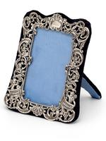 Small William Comyns Silver Photo or Picture Frame Decorated with Cherubs, Scrolls and Flowers