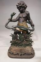 Quite Famous Late 19th Century Cast Iron Stick Stand of a Child Fighting a Serpent
