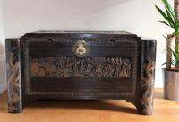 Chinese relief carved camphorwood coffer with an ebonised finish