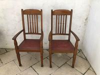 A Pair of Arts and Crafts Oak Chairs