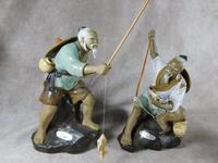 Two Chinese Shiwan 'Shekwan' Mud Man figures of fishermen