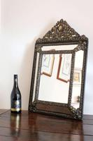 Dutch Repousse Brass Cushion Framed Mirror with Arched Crest
