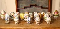 A Collection of Ceramic Egg Trinket Boxes, in Original Art Deco Display Shelf