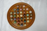 Set of French Marble Orbs on a Turned Solitaire Board