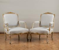 A Pair of Large French Louis XV Style Gilt and Painted Upholstered Bergere Armchairs