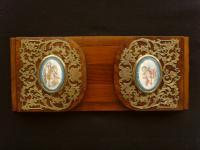 Extending Burr Walnut Book Rack with Brass Mounts & Ceramic Plaques