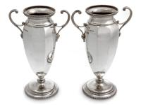 Pair of Eight Panelled Silver Vases with Scroll Handles