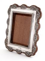 Edwardian Bevelled Glass Silver Photo Frame with a Pierced Scrolling Floral Border
