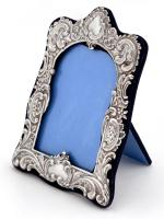 Victorian Silver Frame with a Repousse Floral Scroll Decoration & Two Empty Cartouche