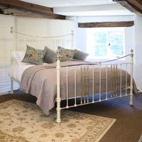 Cast Iron and Brass Bed in Cream