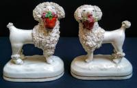 Pair of Staffordshire Poodles Holding Baskets c.1845