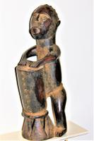 Well Carved Wood African Tribal Figure of a Man Beating a Drum Possibly by the Kongo of West Central Africa