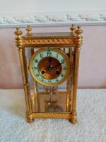Gilt Four-Glass-Sided Clock. Fabrique of Paris